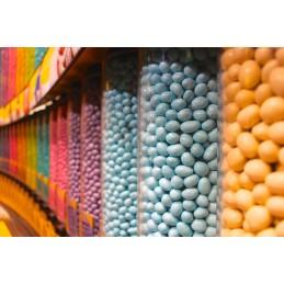 Distributeur de bonbons avec montage mural : mise en situation dans un magasin.